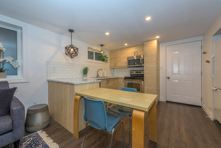Full kitchen with fridge, stove, dishwasher and microwave