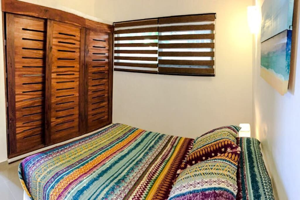 Large closet to get you organized and blackout window shades to assure a good night sleep
