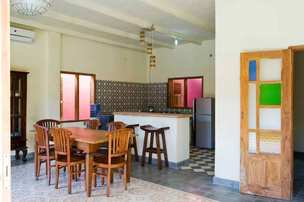 The villa has a nice kitchen with sitting bar and table set
