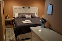 The master bedroom includes an alcove with a full size bed.