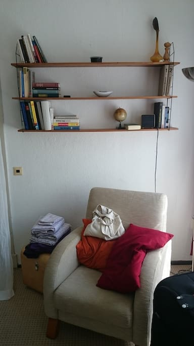 The sofa near windows. It's great to reading here.