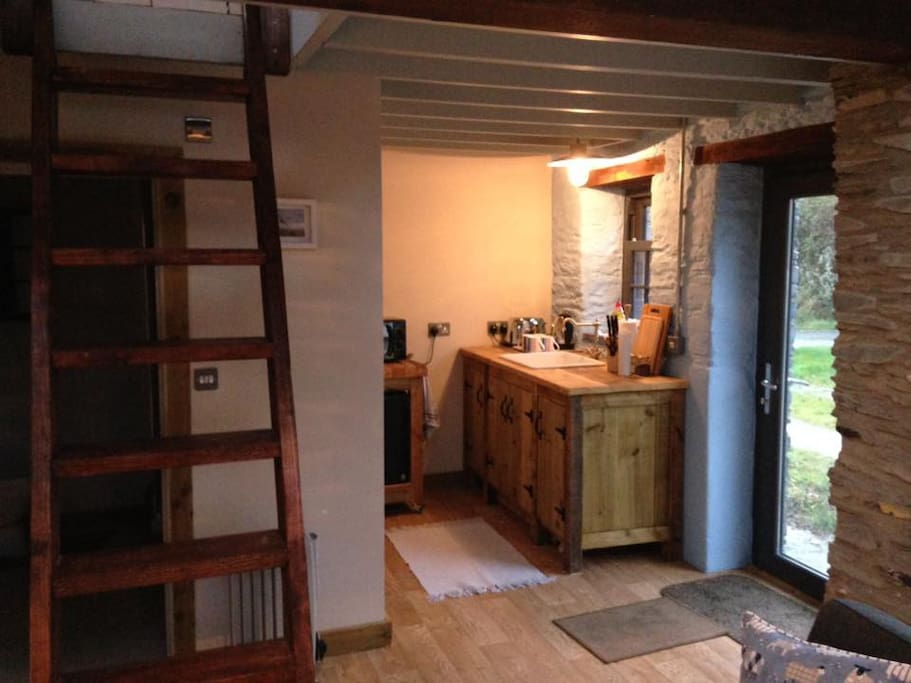 Rustic style Kitchenette,with microwave,kettle, toaster and mini fridge and stair ladder to bed loft & shower room under