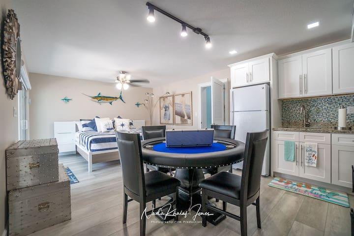 1st-floor studio bedroom game table and kitchenette