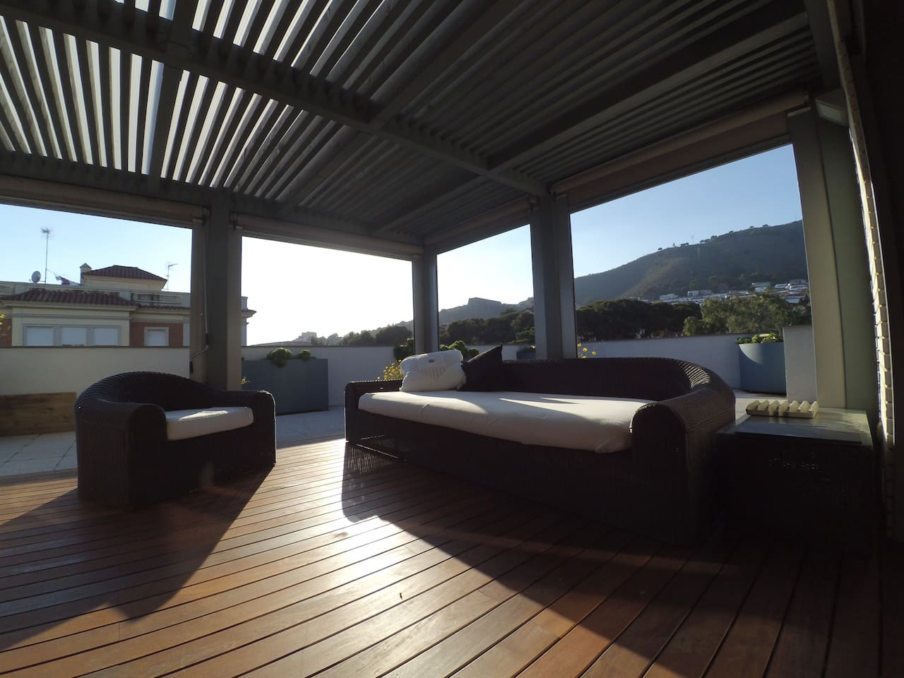 Chill out rooftop terrace with view to the mountains