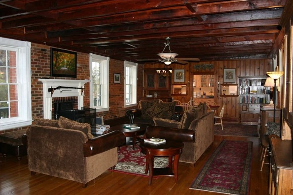 Large open living room/dining room, decorated with antiques. Easy-to-operate pellet stove is in the fireplace (pellets provided!)