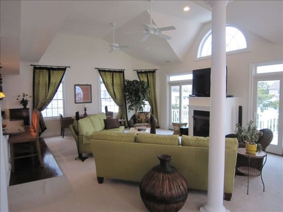 """Family room with 52"""" HDTV and fireplace"""