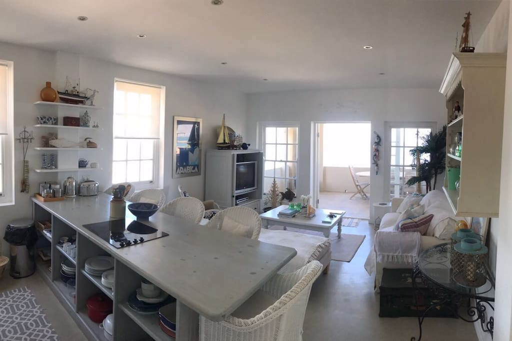 Open planned living and kitchen. Cook and relax whilst enjoying the view of the sea!