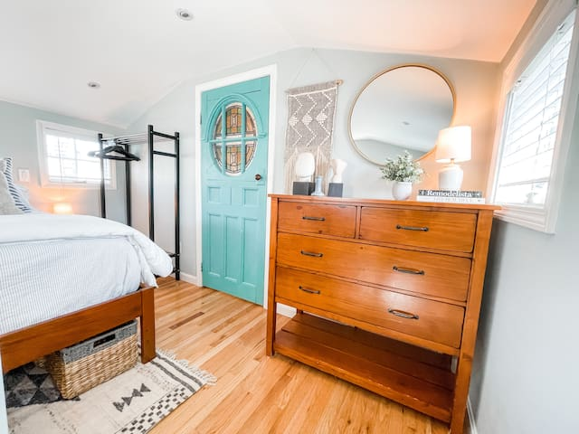 Spacious Loft includes ample storage in dresser, hanging rack, and chest of drawers.