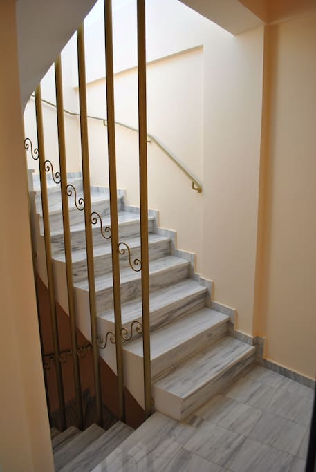 Marble stairs leading to second floor and roof for washer and dryer.