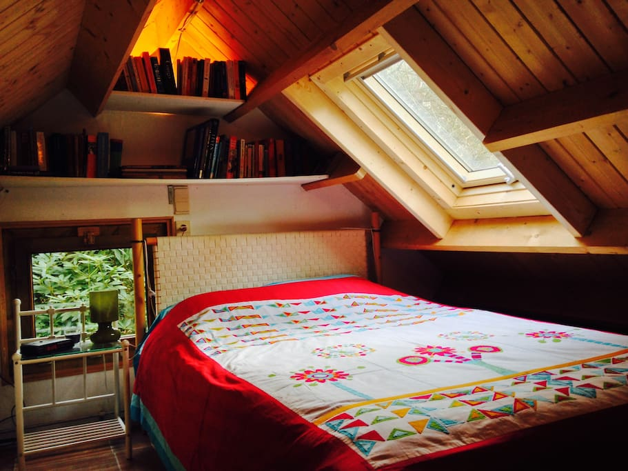 The Nestje - upstairs bedroom in the house with a view to the stars.
