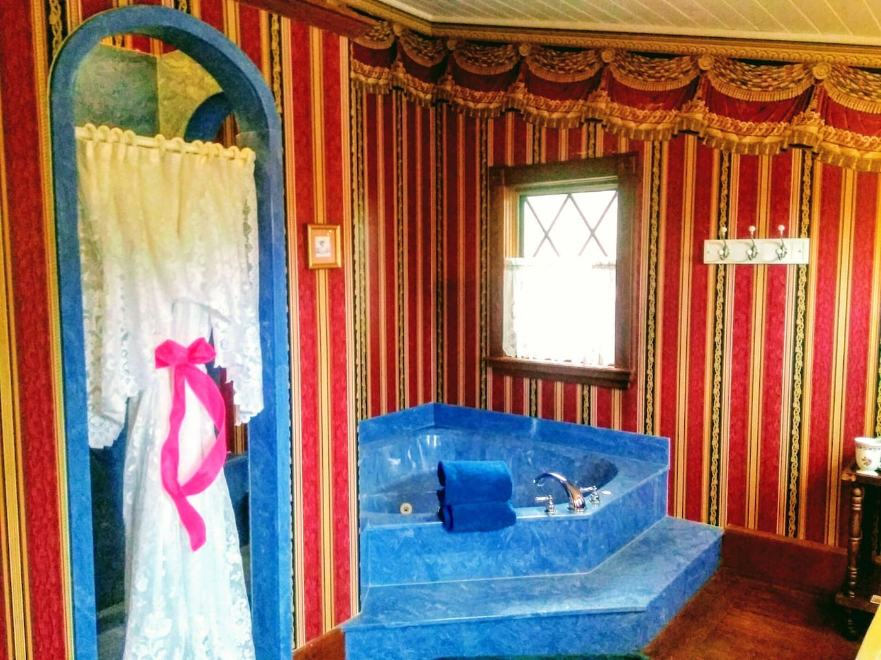 Second floor whirlpool suite in historic section of building.  Original heartpine floors, fire mantel and tall ceilings. Queen four poster bed, remote controlled electric fireplace with flame color features.