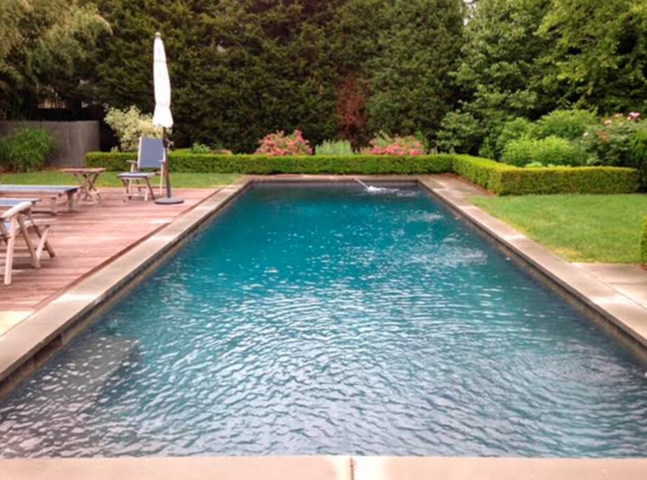 Enjoy a heated, gunite pool surrounded by lush gardens.