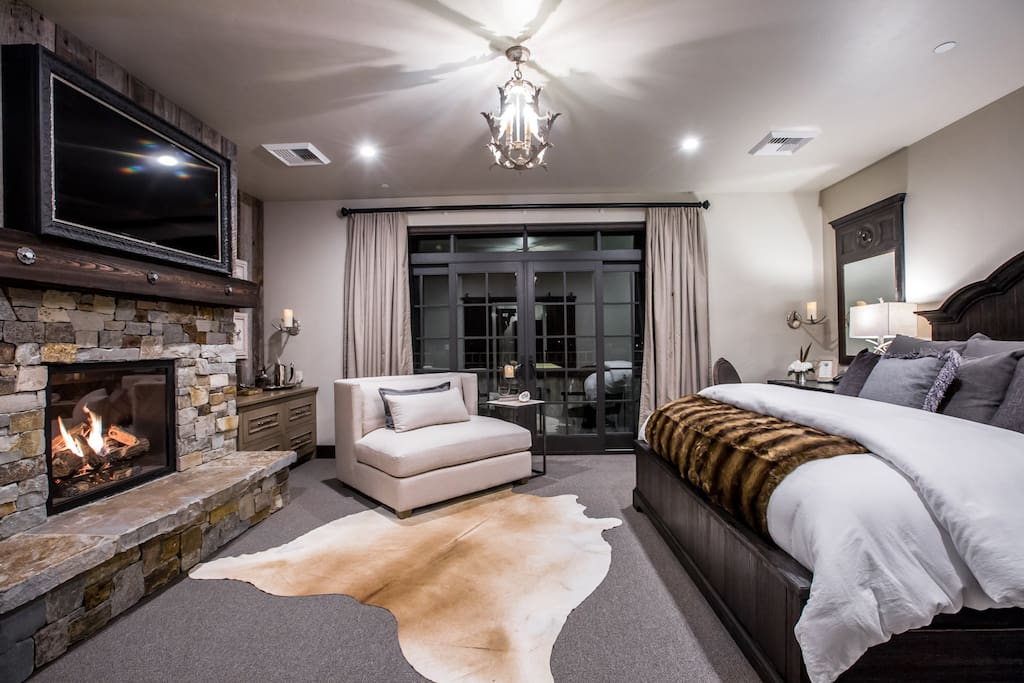 Bedroom with King bed, fire place, TV, and balcony-  Galleries Lodging
