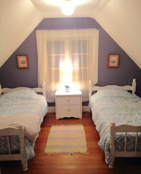 This is the cute upstairs bedroom .