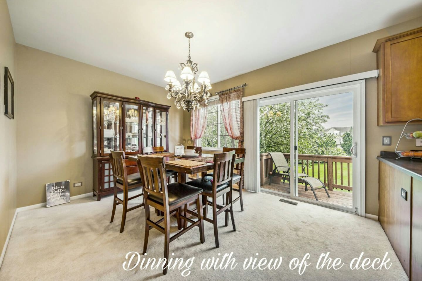 Dinning room with the view of a quiet back yard.  Recently updated flooring with laminate throughout besides bedrooms.