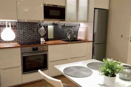 Modern apartment near station, close to Stockholm