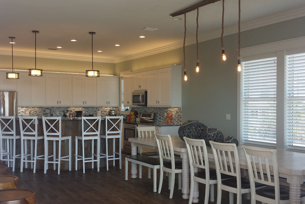 Huge gourmet kitchen, oversized dining table that seats 12-14 and island dining for an additional 7.