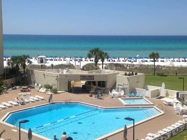 The only thing between you & the beach is the pool