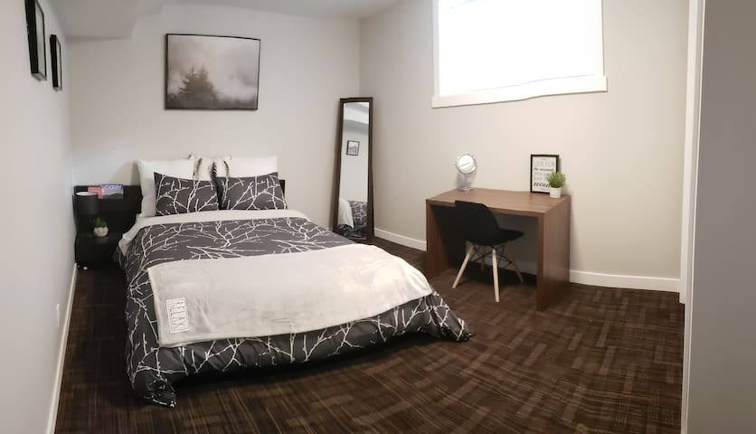 The main bedroom is equipped with a desk and chair for anyone who needs a workstation during their stay.