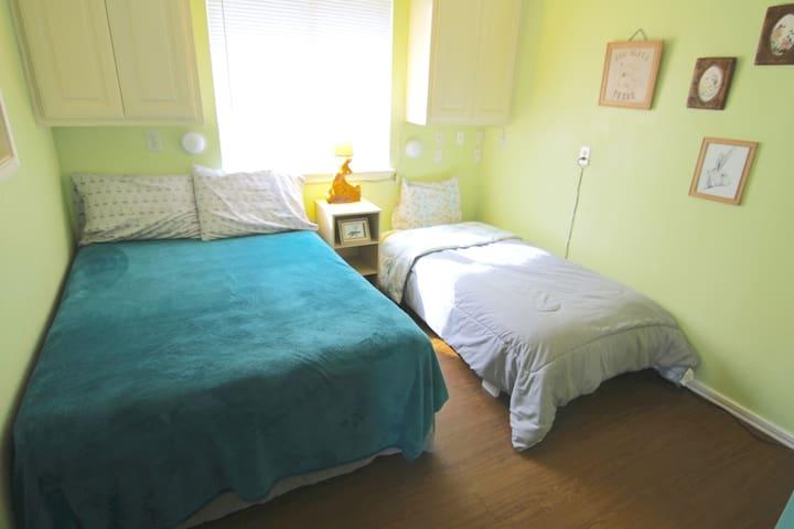 Second bedroom: Full bed, twin bed, fan.