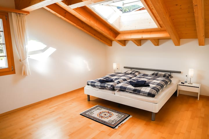 This one is the biggest bedroom in the apartment and you can literally sleep under the stars. By a push of a button, which is located next to the door, a cover will roll out and darken the room. Additionally, you will find in this room a baby bed.
