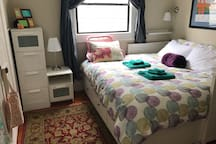 This is the private guest bedroom where you will be sleeping.  King bed (two twins next to each other), desk, drawers, closet space.