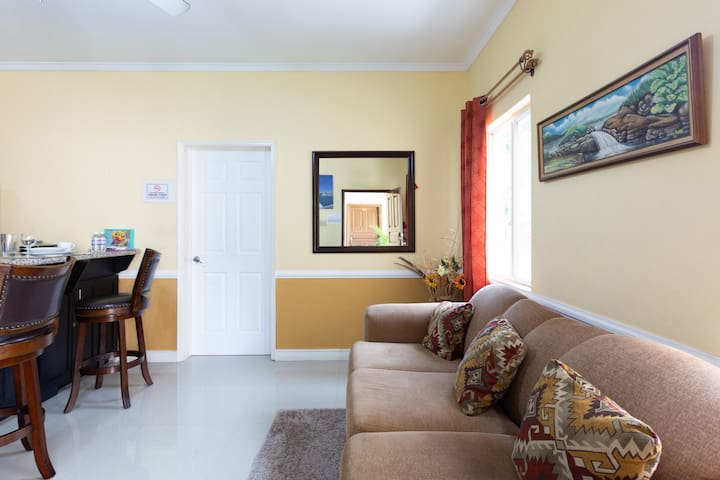 *Spacious living area with sofa bed * Ceiling fan plus standing fan *Smart TV