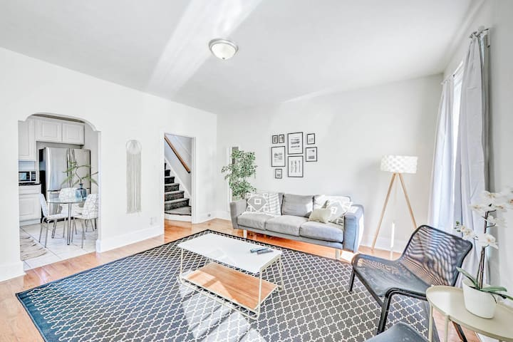 Bright and spacious living room on the first level, comfortably seats five guests! Stairs in the background lead to the two bedrooms above.