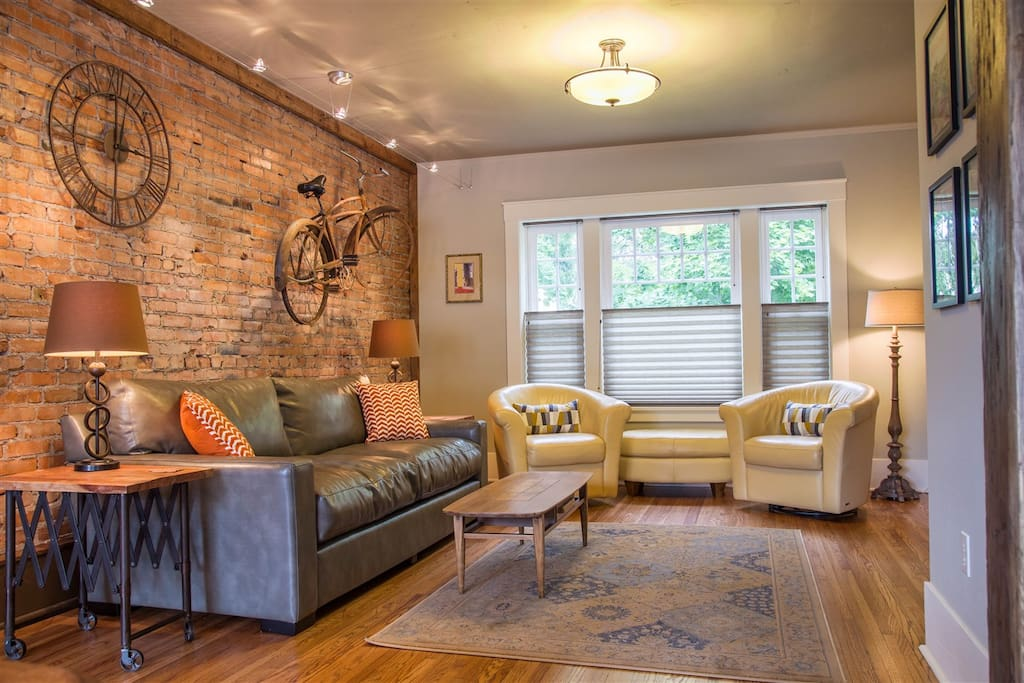 Original brick wall, comfortable seating and flat screen tv with cable.