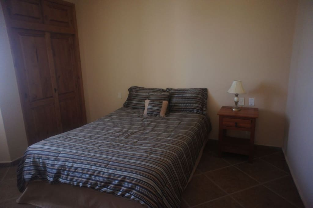 Guest bedroom comes with a comfortable queen size bed.
