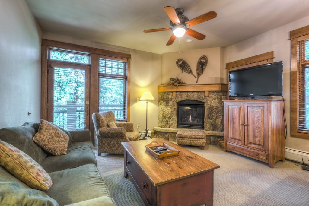The living area features a gas fireplace, flat screen TV and a queen-sized sleeper sofa.