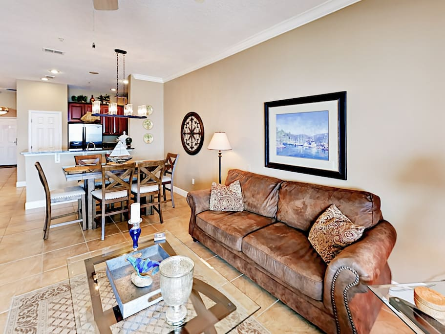 "The living room includes comfy seating for 5 as well as a 58"" flat screen TV with cable and a DVD player."