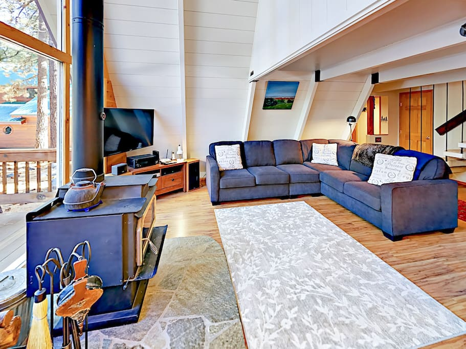 """Sprawl out on the sectional sofa and watch shows on the 50"""" flat screen TV."""