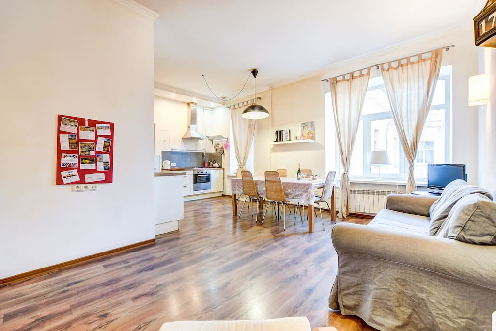 Kitchen with living room and our red table with all advice about Saint Petersburg!