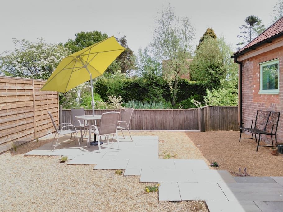 The rear garden overlooks the pond and has space for eating out, including a BBQ