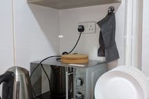 Kettle and microwave are provided.