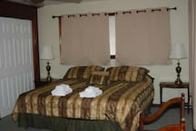 Master Bedroom with two large closets, King Size bed overlooking pool and 12 acres.