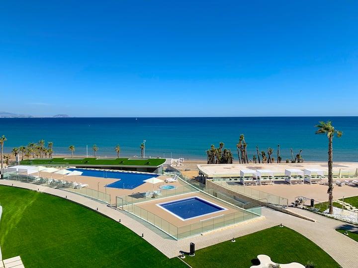 Luxury apartment in San Juan beach, HEATED POOL.