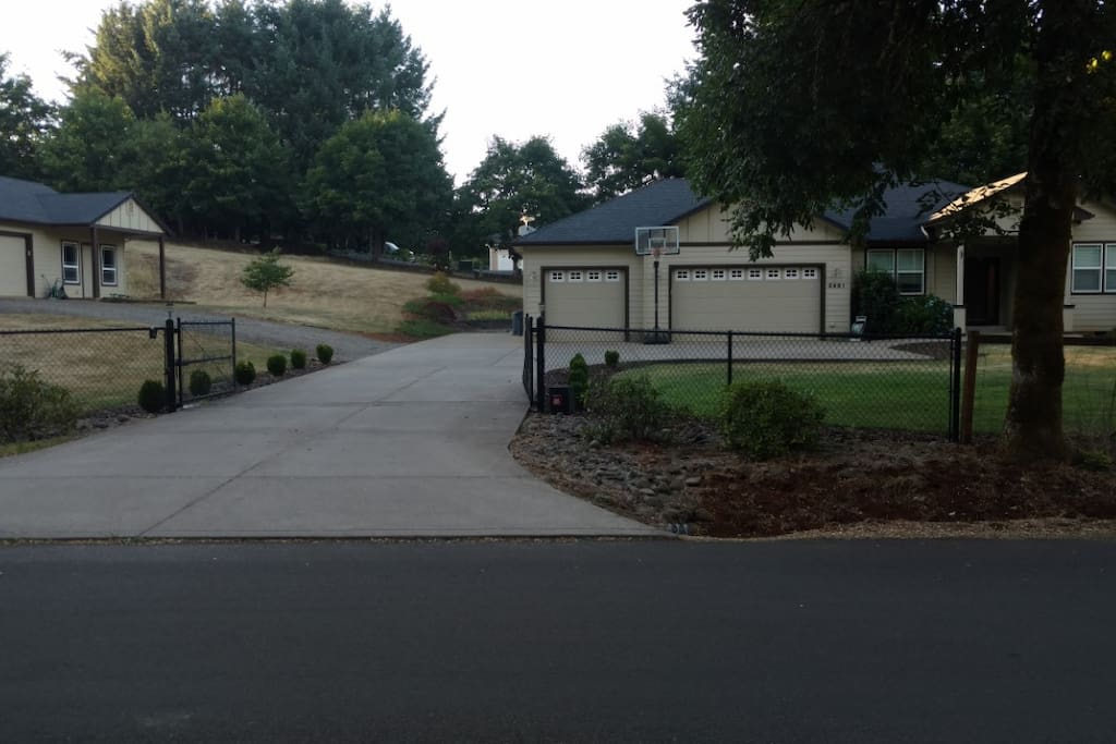 Driveway entrance with main house on right and guesthouse on left