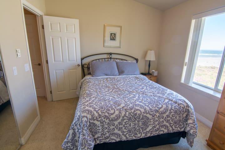 Queen bed in second suite