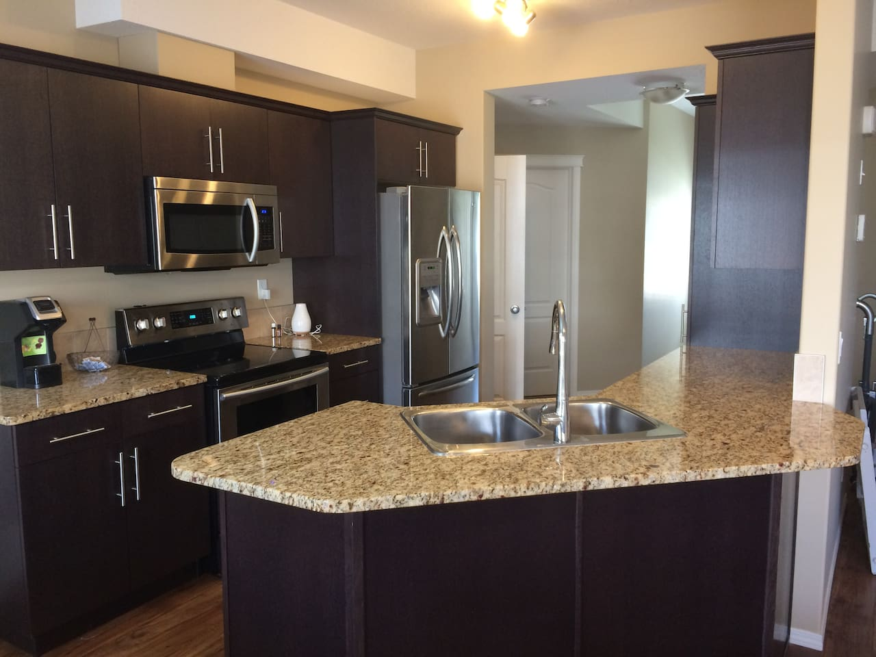 Kitchen with Granite Countertops, fridge has ice and water,  and dishwasher (not showing)