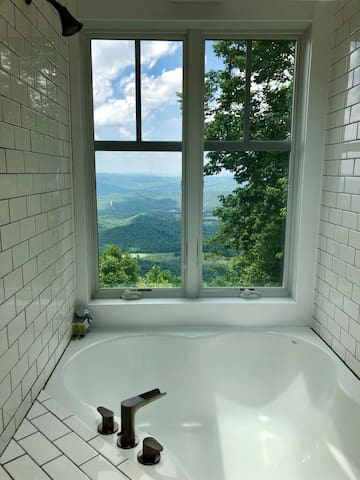 The loft hides a extravagant soaker tub with an unparalleled view. Even better, in the winter, step out onto HEATED TILE FLOOR (upstairs and down)