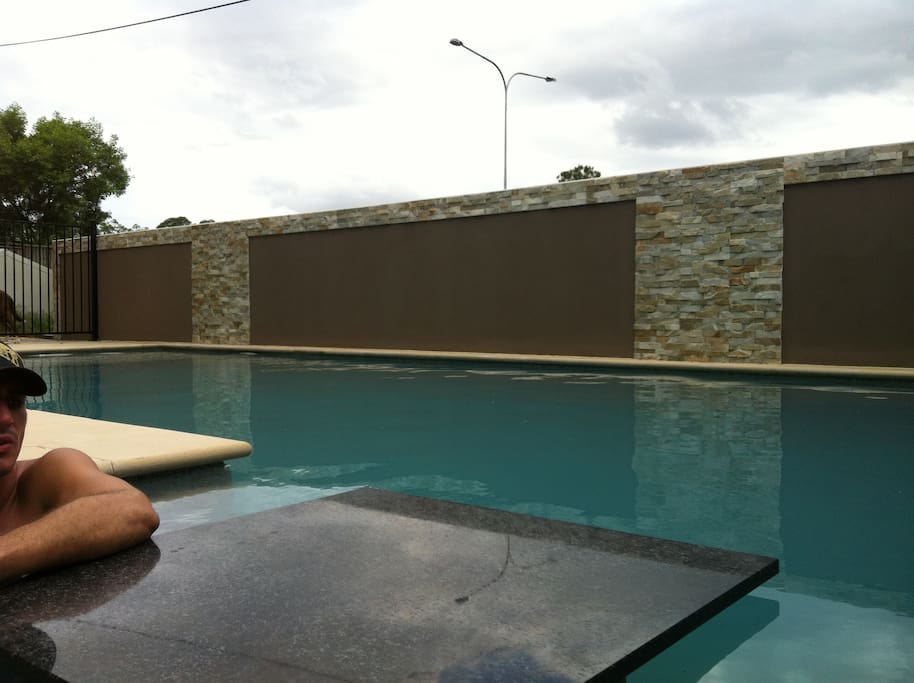 Inground pool with built in table and shelf seating recess - perfect for relaxing with a couple of drinks or sit  and watch as the children do laps