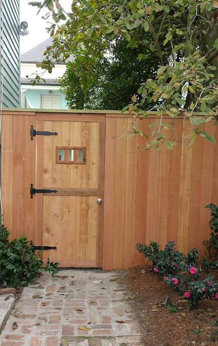 Locking entrance adds security to backyard entrance to carriage house.