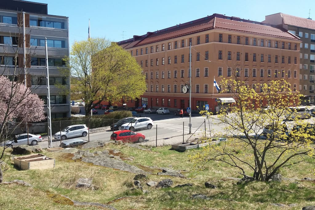 This is how the house looks from outside. It's quite easy to spot; it's orange, it's next to one of the highest spots in Turku, and there's even a clock showing you when to turn.