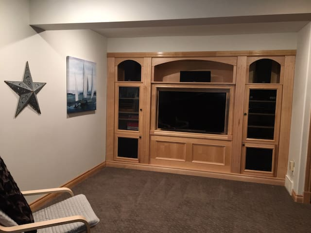 The family room includes a custom  entertainment centre with a Smart TV.