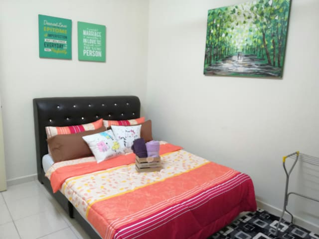 Master bedroom with Queen size bed. Equipped with ceiling fan and Air Conditioning. Attached with bathroom.