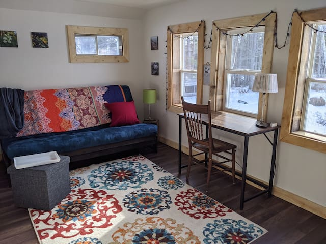 Loft. Futon can be pulled out and used as a full sized bed. Bedding stored in foot stool. Writing desk looks out toward the west. Watch eagles and other animals.