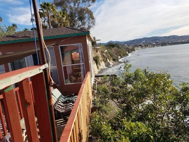 Bedroom hangs over the cliff, nothing but ocean below