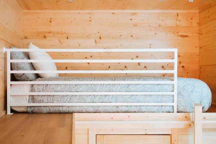 Foam twin bed in other loft.